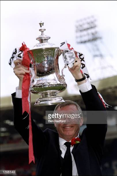 Alex Ferguson the manager of Manchester United celebrates with the trophy after the AXA FA Cup Final match against Newcastle United played at Wembley...