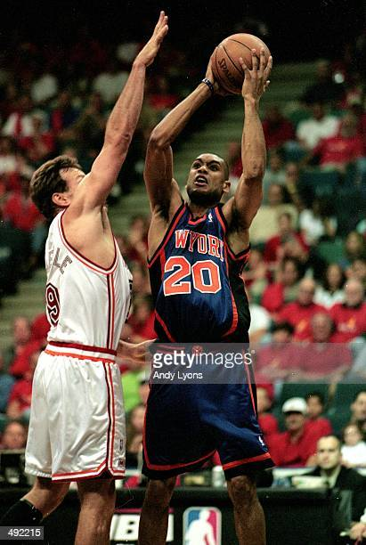 Allan Houston of the New York Knicks shoots the ball while Dan Majerle of the Miami Heat tries to defend him during the first round play offs at the...