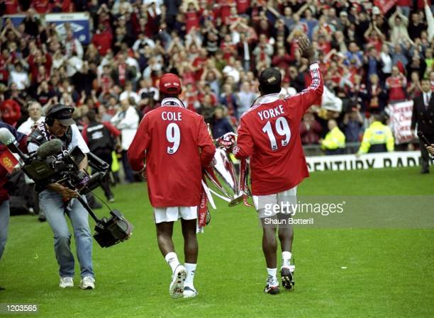 Andy Cole and Dwight Yorke of Manchester United celebrate winning the title during the FA Carling Premiership match against Tottenham Hotspur played...