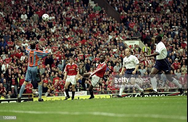 Andy Cole of Manchester United scores a superb winning goal over Ian Walker during the FA Carling Premiership match against Tottenham Hotspur played...