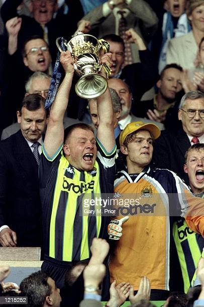 Andy Morrison the captain of Manchester City lifts the play-off trophy during the Nationwide Division Two Play-Off Final match against Gillingham...