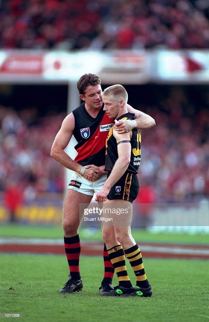 Barry Young of the Essendon Bombers shakes hands with Natthey Knights of Richmond during the Round 6 AFL Football match against Richmond played at the MCG in Melbourne, Australia. \ Mandatory Credit: Stuart Milligan /Allsport