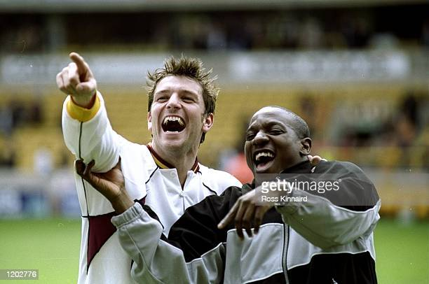Bradford City players Lee Sharpe and Isiah Rankine celebrate promotion to the FA Carling Premier League after the Nationwide Division One match...
