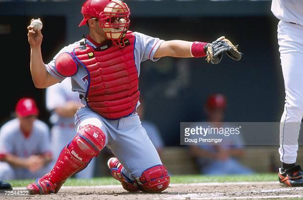 Catcher Ivan Rodriguez of the Texas Rangers ready to throw the ball from home plate during the game against the Baltimore Orioles at Camden Yards in...