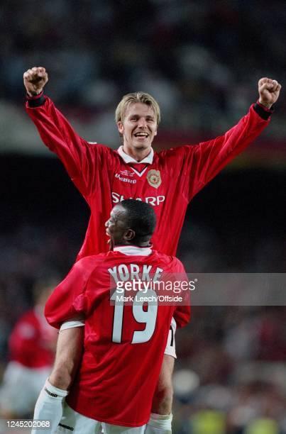 May 1999 - Champions League Final - Manchester United v FC Bayern Munich - David Beckham and Dwight Yorke of Man Utd celebrate victory -