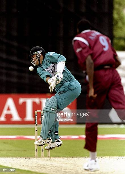 Craig McMillian of New Zealand challenged by a delivery from Curtly Ambrose of the West Indies during the Cricket World Cup Group B match played in...