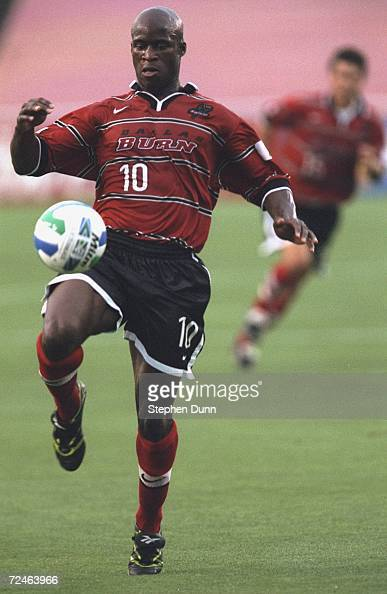 Dante Washington of the Dallas Burn knees the ball during the game against the Miami Fusion at the Cotton Bowl in Dallas Texas The Burn defeated the...