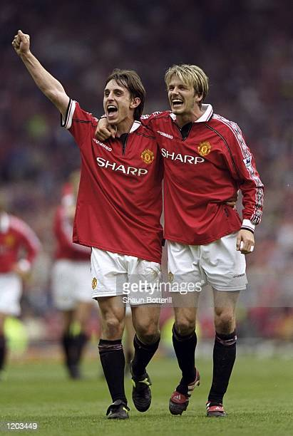 David Beckham and Gary Neville of Manchester United celebrate winning the title during the FA Carling Premiership match against Tottenham Hotspur...