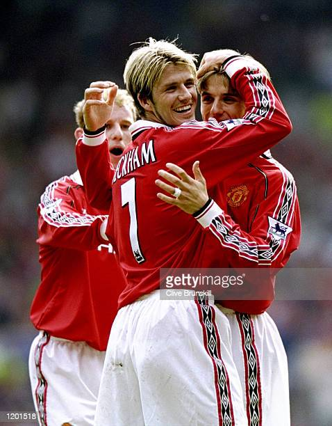 David Beckham and Phil Neville of Manchester United celebrate a goal during the FA Carling Premiership match against Aston Villa played at Old...
