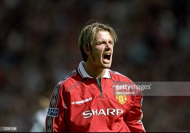 David Beckham of Manchester United celebrates victory after the AXA FA Cup Final match against Newcastle United played at Wembley Stadium in London...