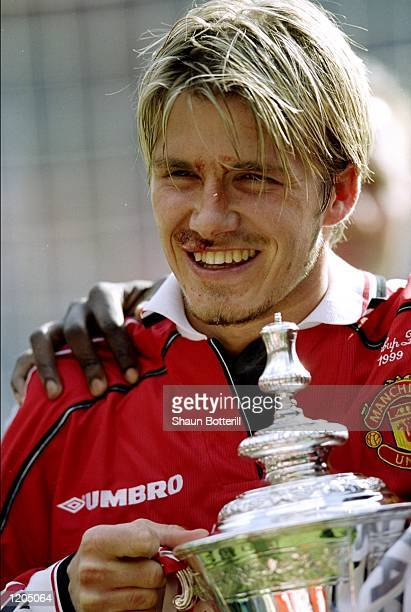 David Beckham of Manchester United celebrates victory with the trophy after the AXA FA Cup Final match against Newcastle United played at Wembley...