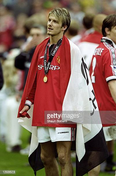 David Beckham of Manchester United celebrates winning the title during the FA Carling Premiership match against Tottenham Hotspur played at Old...