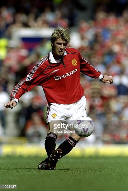 David Beckham of Manchester United passes the ball during the FA Carling Premiership match against Aston Villa played at Old Trafford in Manchester...