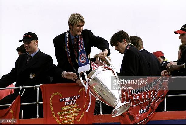 David Beckham shows off the European Cup as Manchester United parade through Manchester after victory in the UEFA Champions League Final Mandatory...