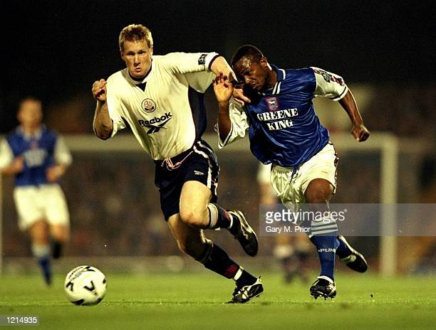 David Johnson of Ipswich Town battles with Andy Todd of Bolton Wanderers during the Nationwide Division One SemiFinal PlayOff 2nd leg match against...