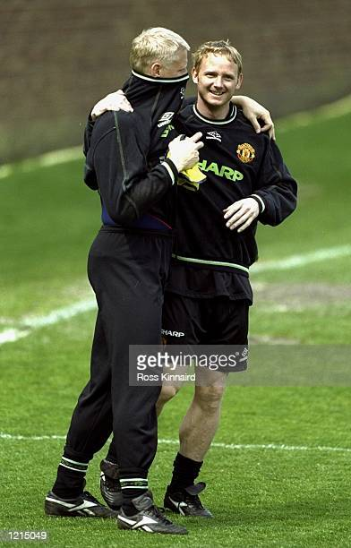 David May and Peter Schmeichel of Manchester United during training at the Cliff Training Ground in Manchester England Mandatory Credit Ross Kinnaird...