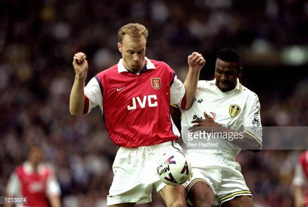Dennis Bergkamp of Arsenal in action against Lucas Radebe of Leeds United during the FA Carling Premiership match against Leeds United played at...