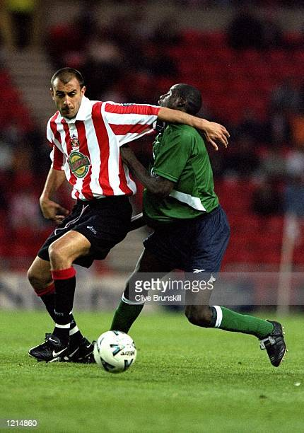 Djimi Traore of Liverpool in action against Daniel Dichio of Sunderland during the 100th League Championship Challenge match against Sunderland...