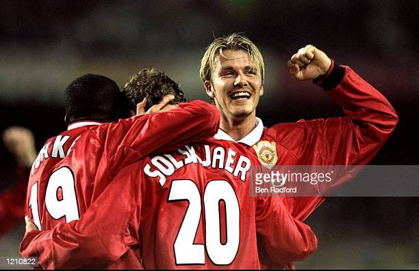 Dwight Yorke Ole gunnar Solskjaer and David Beckham celebrate victory in the European Champions League Final against Bayern Munich in the Nou Camp...