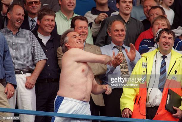 09 May 1999 English Football League Division One Queens Park Rangers v Crystal Palace QPR manager Gerry Francis throws his shirt to the crowd below...