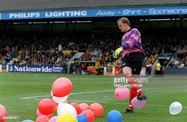08 May 1999 English Football League Division Three Cambridge United v Brentford FC Brentford goalkeeper Andy Woodman tries to deal with balloons...