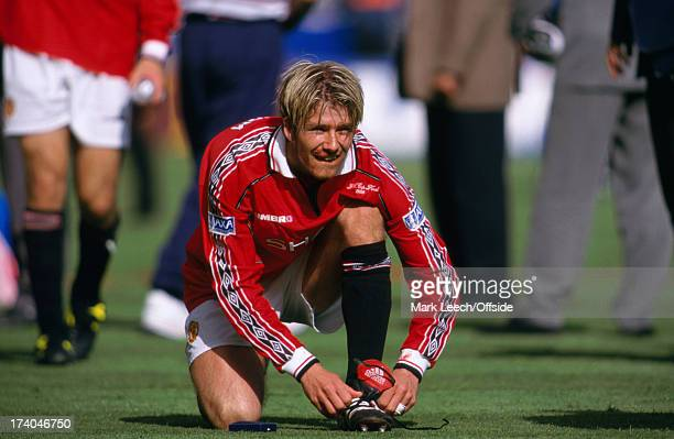 22 May 1999 FA Cup Final Manchester United v Newcastle United David Beckham laces up his boot after the match