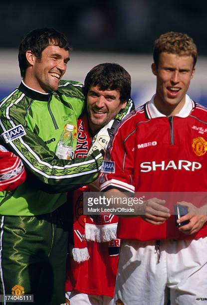 22 May 1999 FA Cup Final Manchester United v Newcastle United Goalkeeper Raimond van der Gouw hugs Manchester captain Roy Keane as they walk behind...