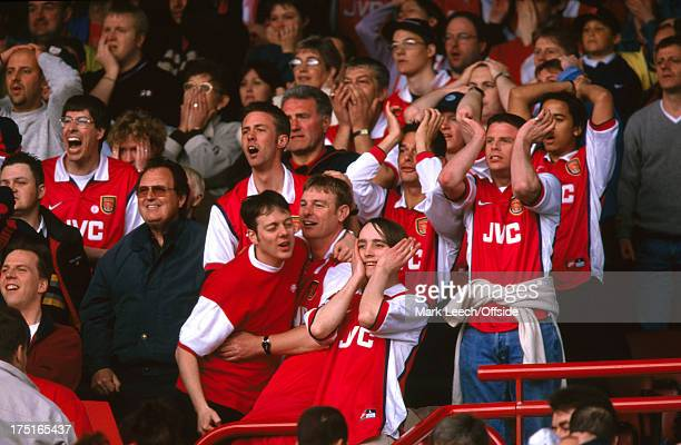 16 May 1999 FA Premiership Football Arsenal v Aston Villa mass dejection from the Arsenal fans who hold their heads in their hands on the North Bank...