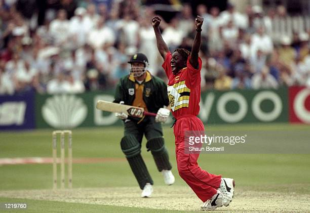 Henry Olonga of Zimbabwe takes the wicket of Allan Donald of South Africa to secure victory in the World Cup Group A game at Chelmsford in England....