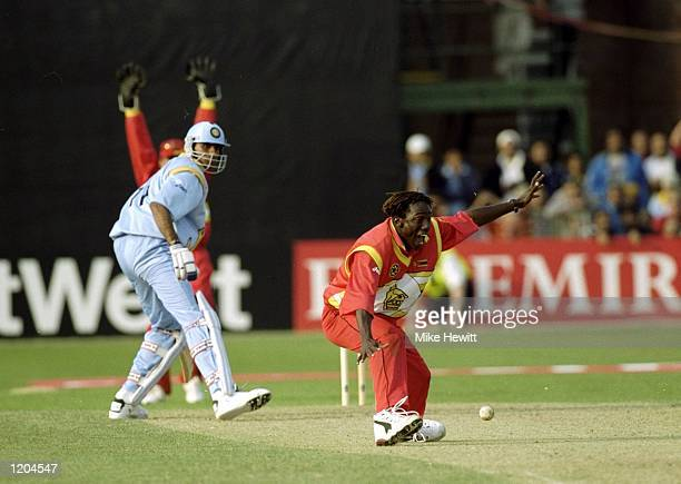 Henry Olonga of Zimbabwe traps Venkatesh Prasad of India and Zimbabwe beat India in the Cricket World Cup Group A match played in Leicester, England....