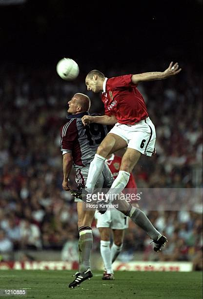 Jaap Stam of Manchester United challenges Carsten Jancker of Bayern Munich during the European Champions League Final in the Nou Camp Stadium...