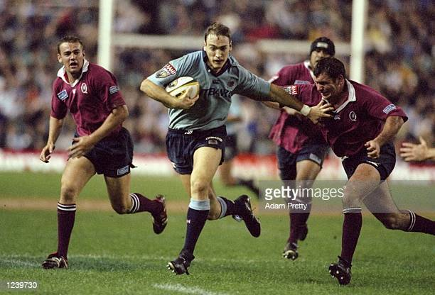 Jason JonesHughes of New South Wales Waratahs istackled by Mark Murray of Queensland during the New South Wales Waratahs v Queensland Super 12 at the...