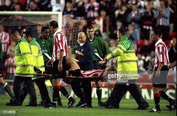 Kevin Phillips of Sunderland is stretchered off the pitch due to injury during the 100th League Championship Challenge match against Liverpool played...