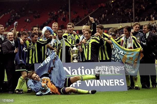 Manchester City players celebrate promotion and victory after the Nationwide Division Two Play-Off Final match against Gillingham played at Wembley...