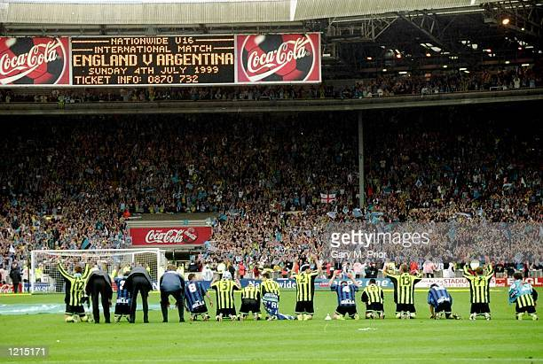 Manchester City players celebrate victory and promotion after the Nationwide Division Two Play-Off Final match against Gillingham played at Wembley...