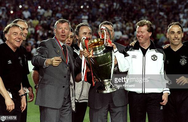 Manchester United manager Alex Ferguson and assistant Steve McClaren celebrate with the trophy after victory over Bayern Munich in the UEFA Champions...