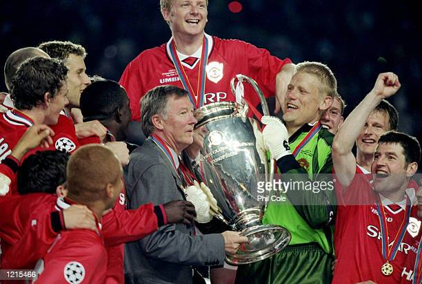 Manchester United manager Alex Ferguson and keeper Peter Schmeichel with the trophy after a 21 victory over Bayern Munich in the UEFA Champions...