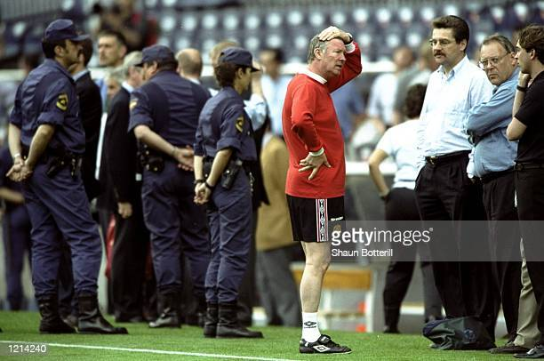 Manchester United manager Alex Ferguson wears a relica 1968 European Cup final top during training for the UEFA Champions League final against Bayern...