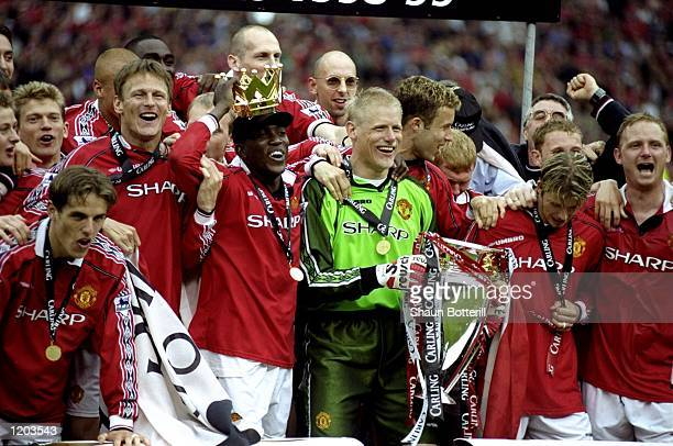 Manchester United players celebrate winning the title during the FA Carling Premiership match against Tottenham Hotspur played at Old Trafford in...