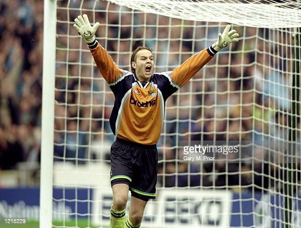Nicky Weaver of Manchester City celebrates after saving a penalty during the Nationwide Division Two Play-Off Final match against Gillingham played...