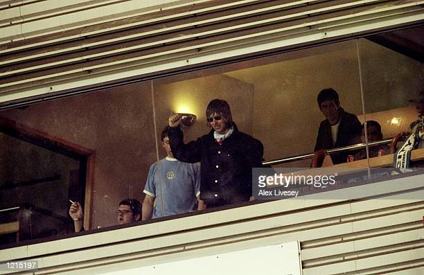 Oasis rock star Liam Gallagher a devoted Manchester City fan waves to the crowds during the Nationwide Division Two Play-Off Final match against...
