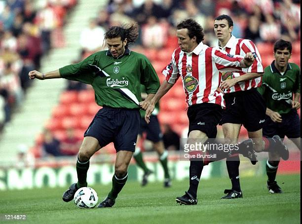 Patrik Berger of Liverpool in action against Nicky Summerbee of Sunderland during the 100th League Championship Challenge match against Sunderland...