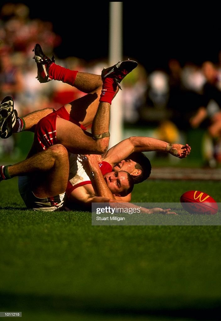 Paul Kelly of the Sydney Swans is tackled during the Round 6 AFL Football match against Fremantle played at the SCG in Sydeny, Australia. \ Mandatory Credit: Stuart Milligan /Allsport