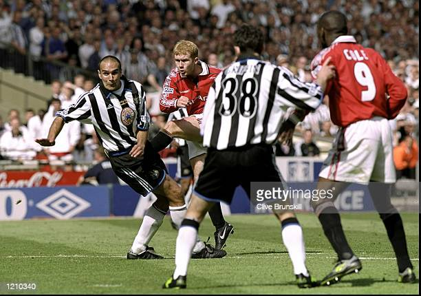 Paul Scholes of Manchester United shoots and scores past the Newcastle defence during the AXA FA Cup Final match against Newcastle United played at...