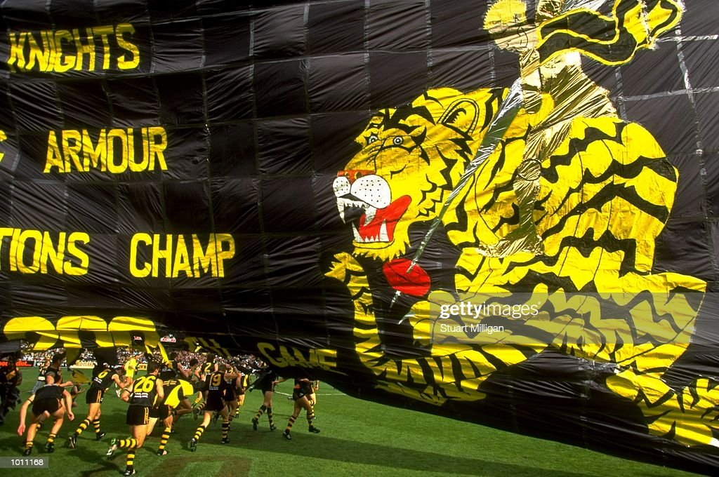 Richmond players burst through the Tigers banner prior to the Round 6 AFL Football match between Richmond and Essendon at the MCG, Melbourne, Australia. \ Mandatory Credit: Stuart Milligan /Allsport