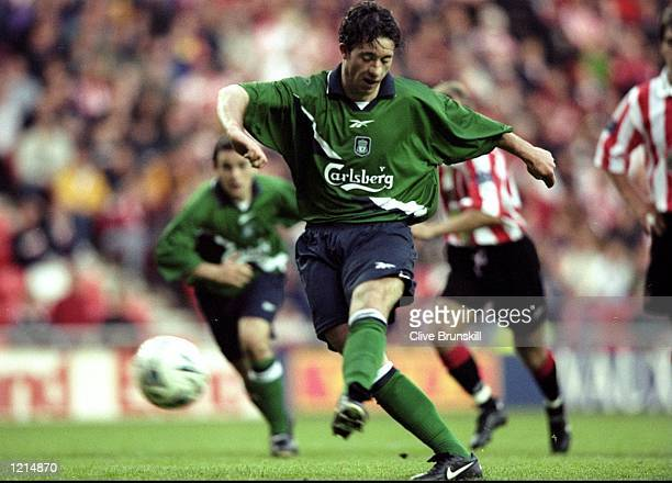 Robbie Fowler of Liverpool takes a penalty and scores during the 100th League Championship Challenge match against Sunderland played at the Stadium...