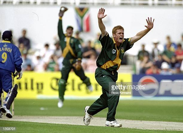 Shaun Pollock of South Africa appeals for the wicket of Aravinda de Silva of Sri Lanka during the Cricket World Cup Group A match played at The...