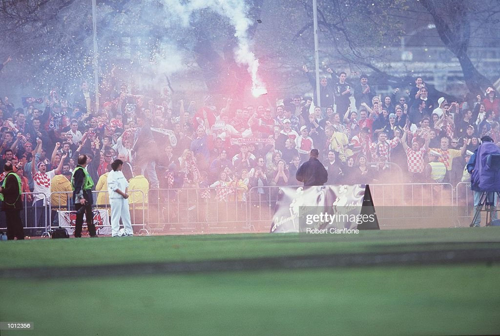 South Melbourne fans set off a flare after a South Melbourne goal is scored during the Ericsson cup grand final between South Melbourne and Sydney United at Olympic park Melbourne, Australia.South Melbourne defeated Sydney United MandatoryCredit: Robert Cianflone/ALLSPORT