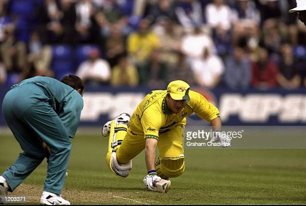 Steve Waugh of Australia dives over the crease during the Cricket World Cup Group B match against New Zealand played at Sophia Gardens in Cardiff...