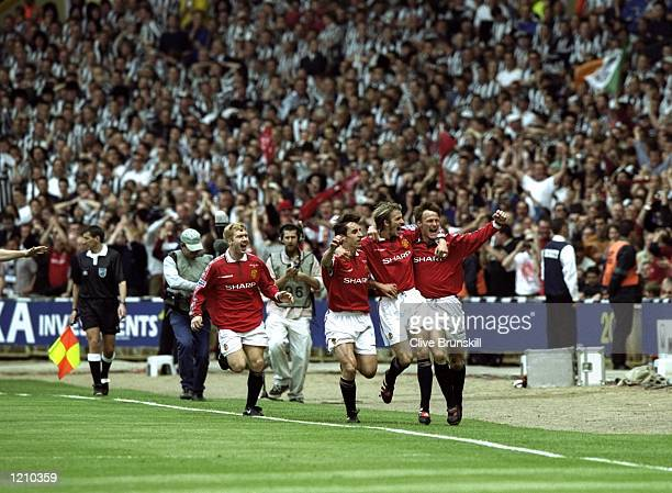 Teddy Sheringham David Beckham Gary Neville and Paul Scholes of Manchester United celebrate the first goal during the AXA FA Cup Final match against...